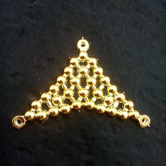 Triangulo Peq ABS Dourado - T. A 080
